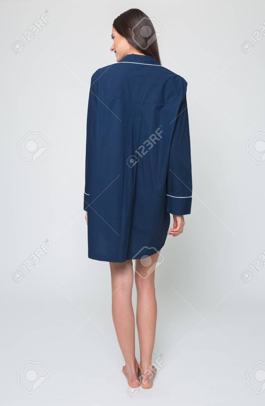 19a692e83e A beautiful tall brunette girl in a dark blue short night pyjama dress,  night wear