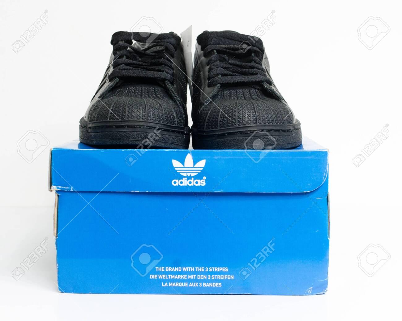 all black adidas shell toes