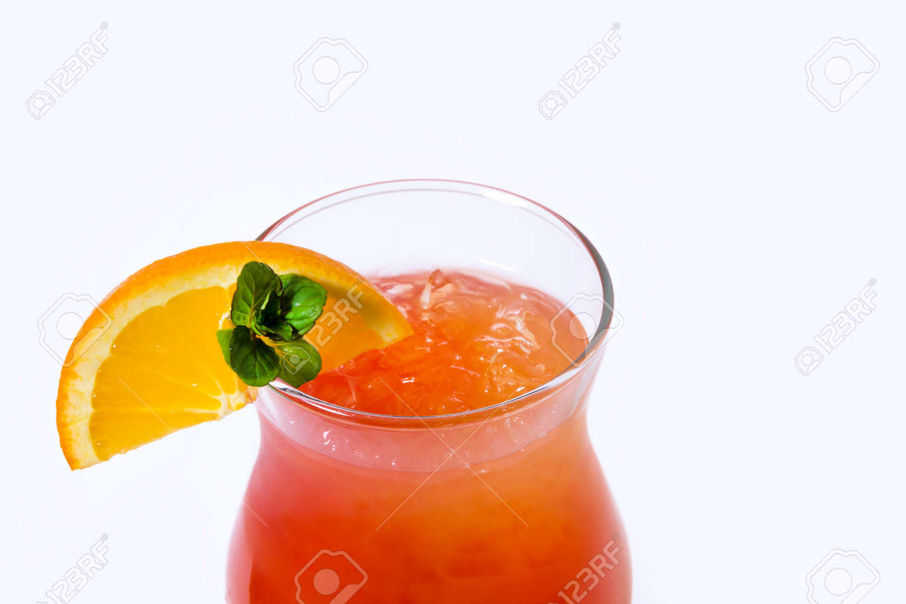Orange cocktail with orange on the edge of the glass - 126898313