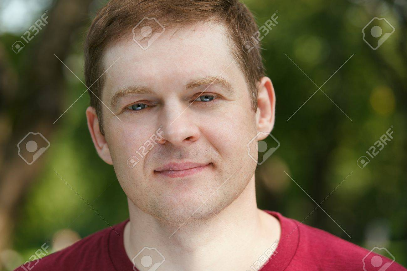 Middle-aged man looking to the camera in the park. Close up portrait. Stock Photo - 20691197
