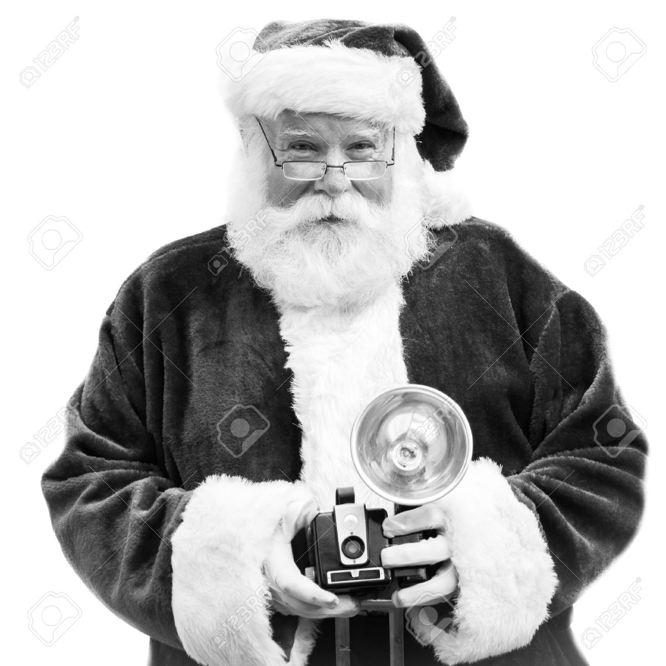 An authentic Santa Claus holds an old Vintage camera in black and white - 22081677