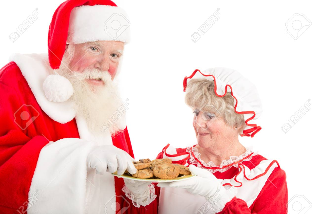 Mrs Clause offers Santa cookies from a plate - 34613549