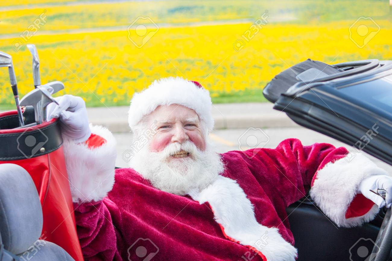 Santa Claus driving a convertible with golf clubs - 48327158