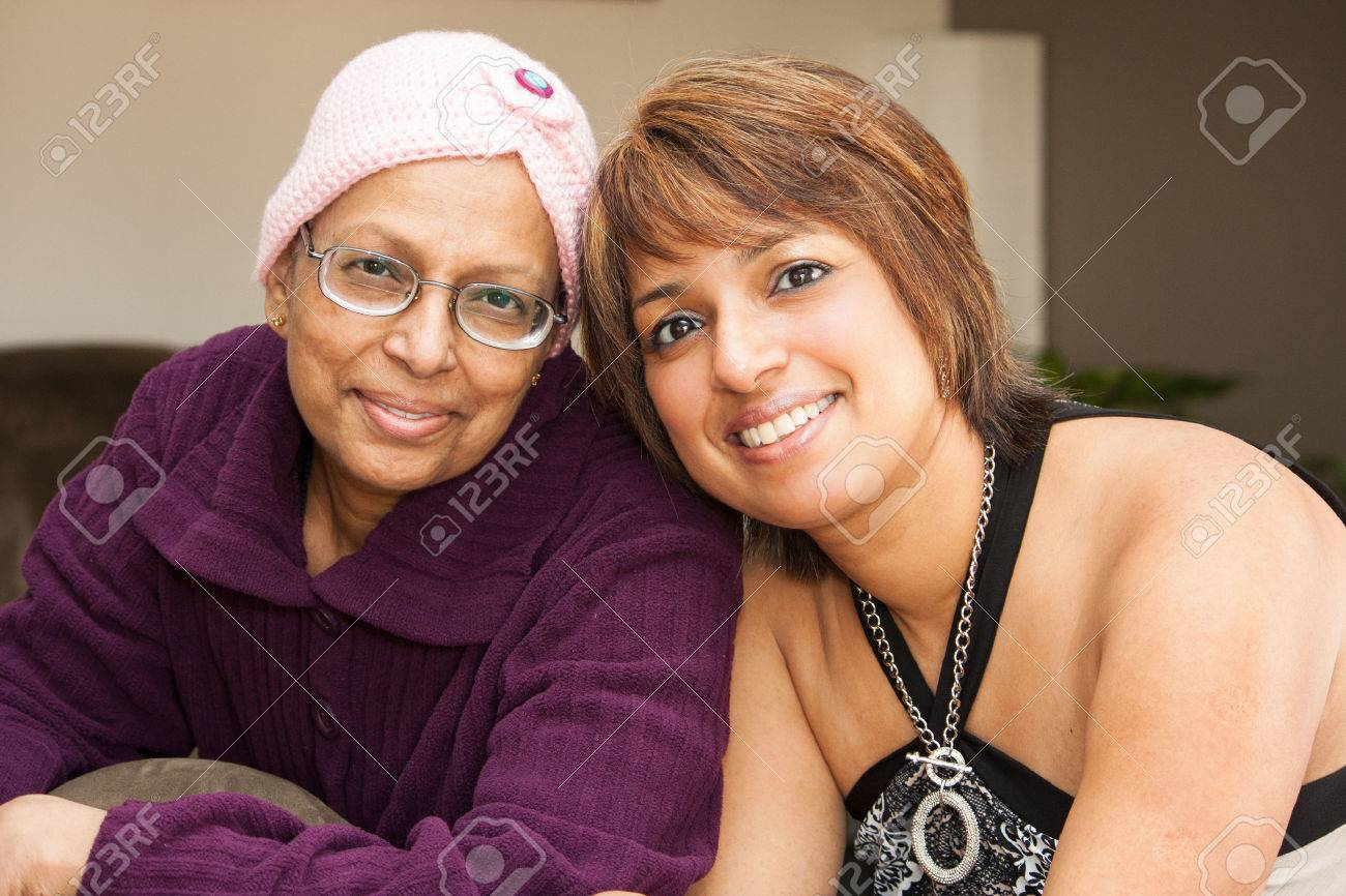 a mother and daughter smile with hopefulness after chemo treatments for cancer - 53142487