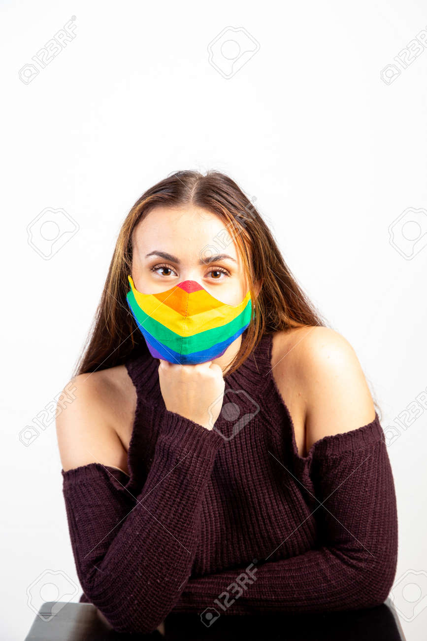 Young woman wearing pride rainbow mask - 166856767