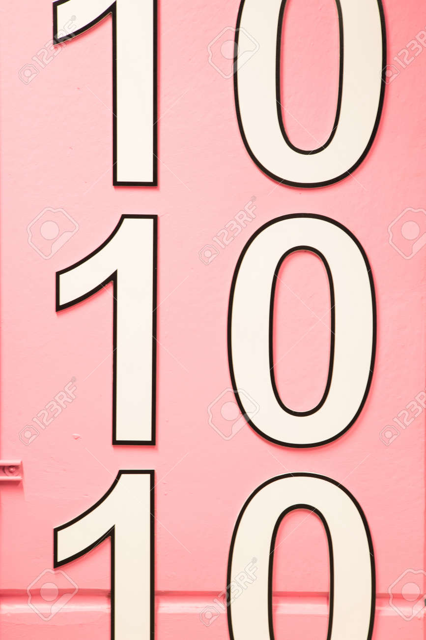 number ten multiple times on pink wall - 166961501