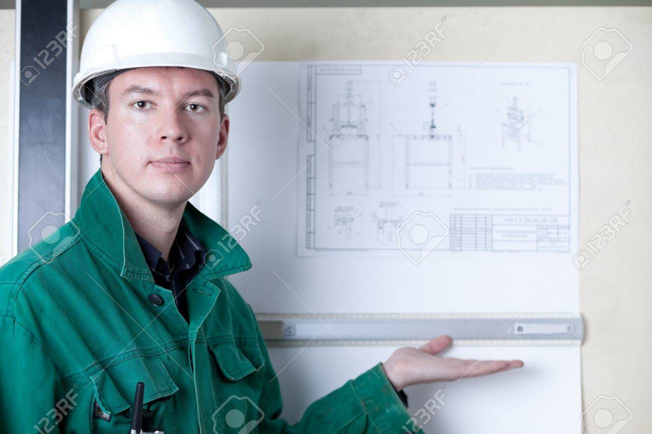 Professional engineer standing by the adjustable board and showing his drawing Stock Photo - 12510601