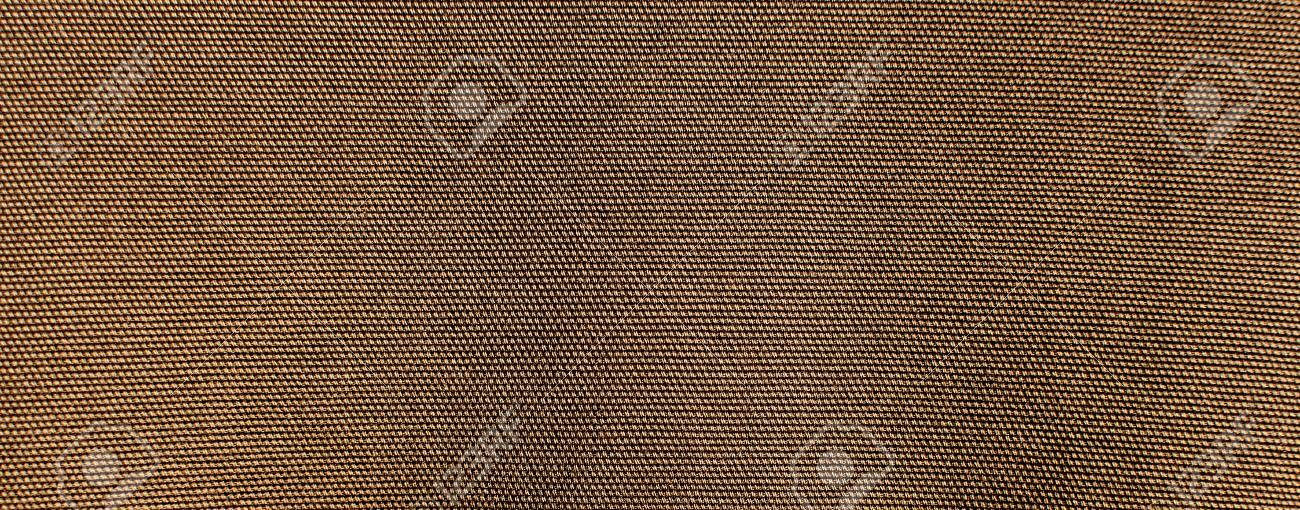 Stock Photo - the textured background or wallpaper of rough cotton fabric. Khaki color