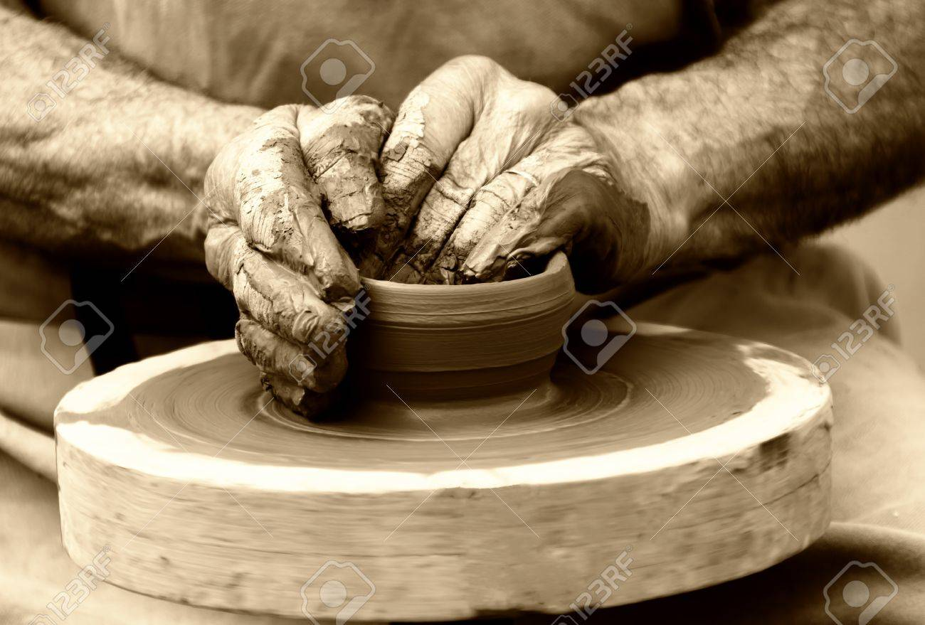 potter on the potters wheel - 12848030