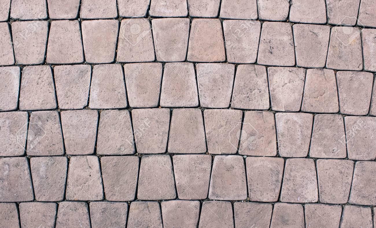Texture di una piastrella quadrata marrone una copertura in pietra