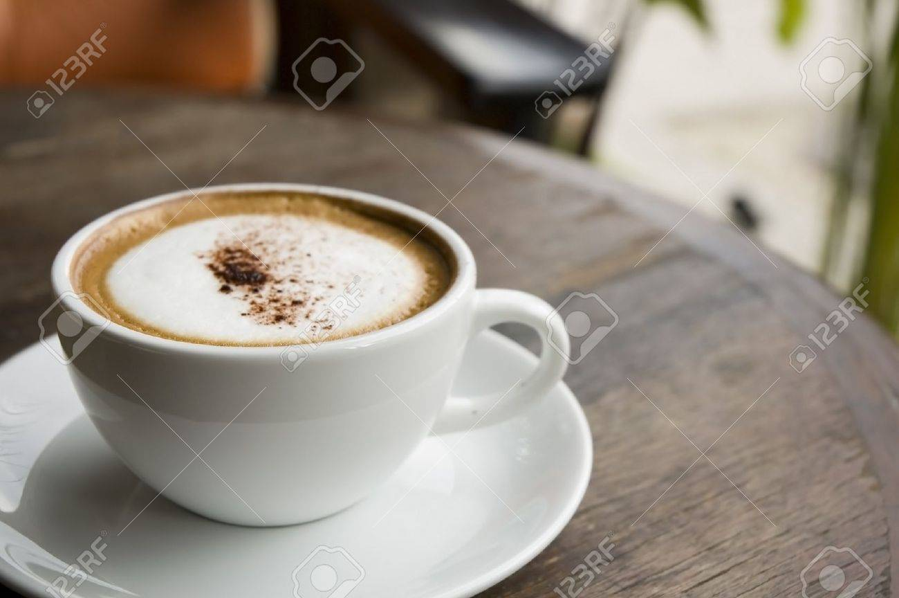 A Cup Of Hot Cappuccino On Table At Outdoor Cafe Stock Photo - Cappuccino coffee table