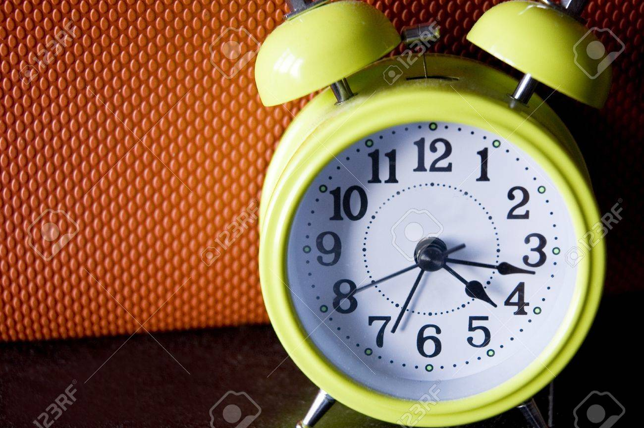 green color alarm clock with orange color background Stock Photo - 11134636