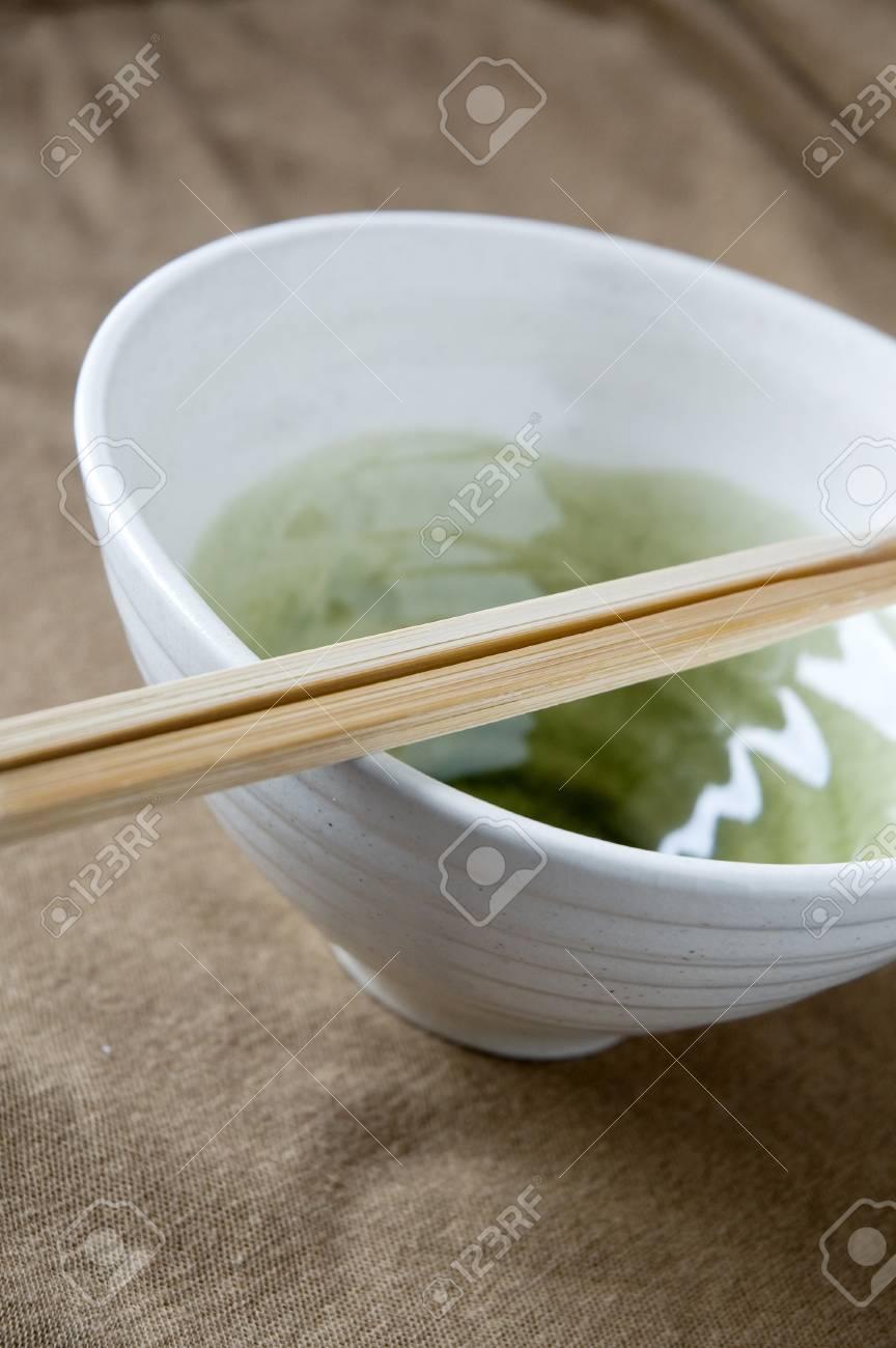 wooden chopstick on white japanese bowl Stock Photo - 15441944