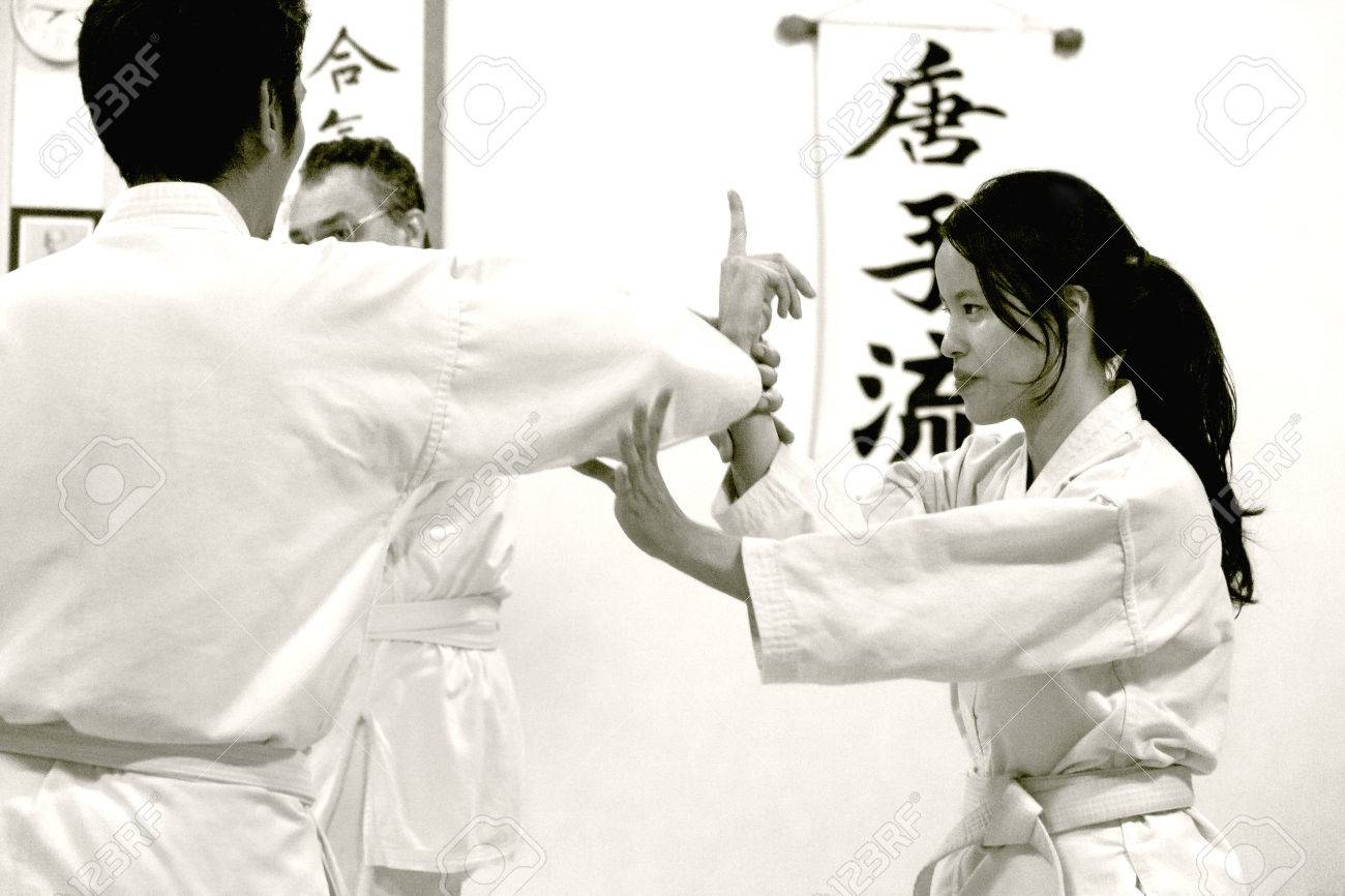 PHUKET TOWN, PHUKET, THAILAND, 3 MARCH 2014: Students of Aikido perform techniques on the mat during a promotion test. - 31155650
