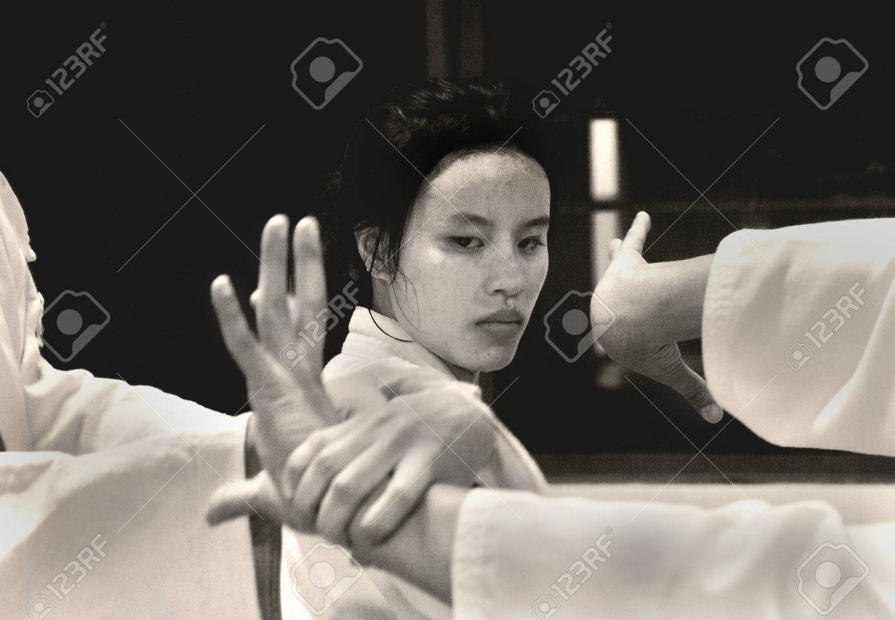 PHUKET TOWN, PHUKET, THAILAND, 3 MARCH 2014: A young Thai college student performs a basic arm lock immobilization with other students during theirr Aikido promotion test. - 31155652
