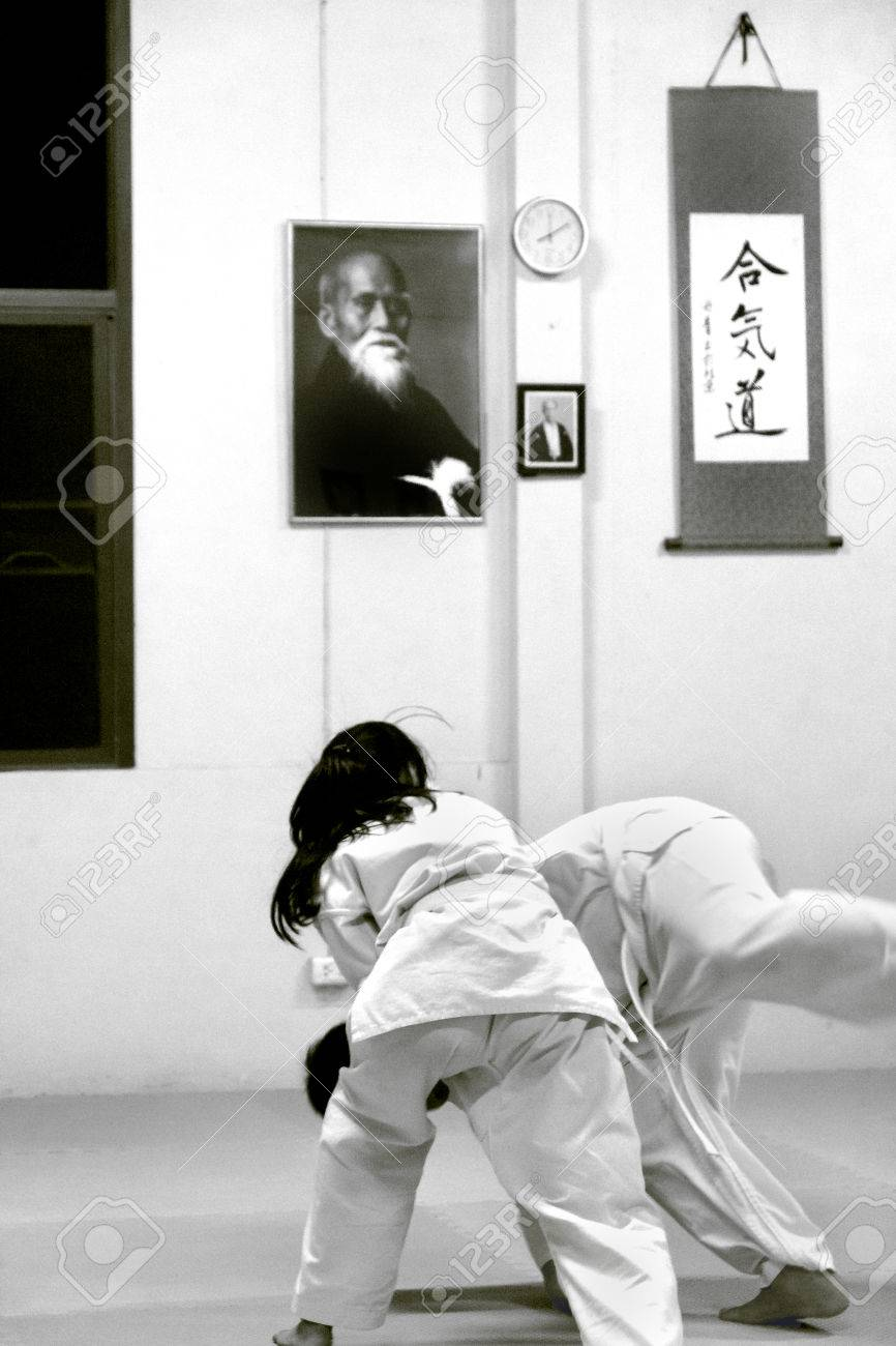 PHUKET TOWN, PHUKET, THAILAND, 3 MARCH 2014: Students of Aikido perform techniques durng a promotion test in Thailand. - 31155659