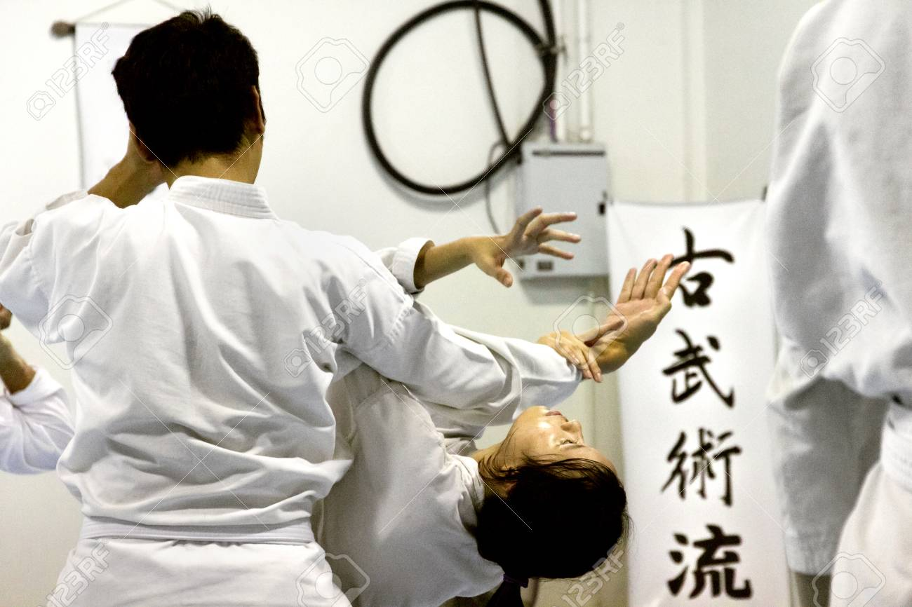 PHUKET TOWN, PHUKET, THAILAND, 3 MARCH 2014: Students of Aikido perform techniques on the mat during a promotion test. - 31155660