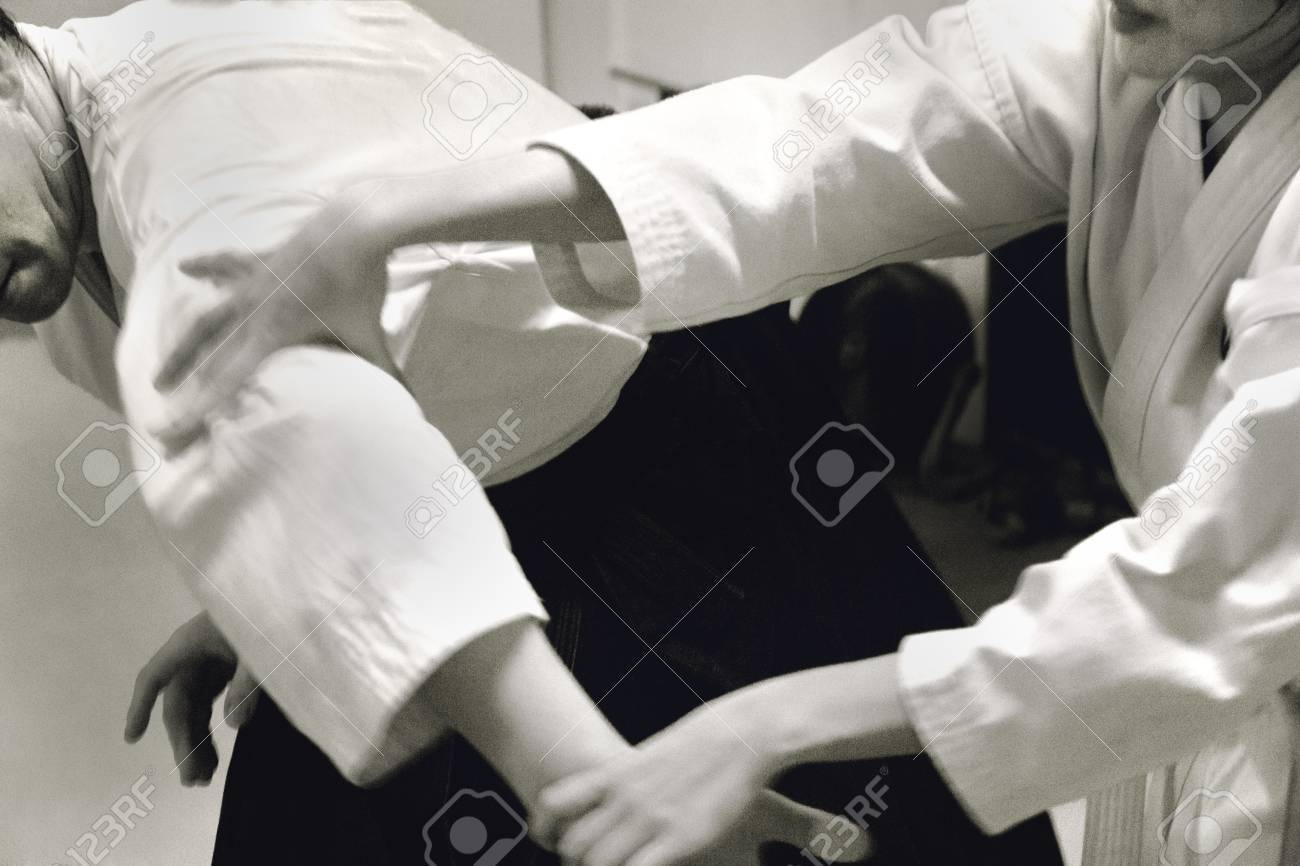 PHUKET TOWN, PHUKET, THAILAND, 3 MARCH 2014: A young Thai college student performs a basic arm lock immobilization during her Aikido promotion test. - 31155662