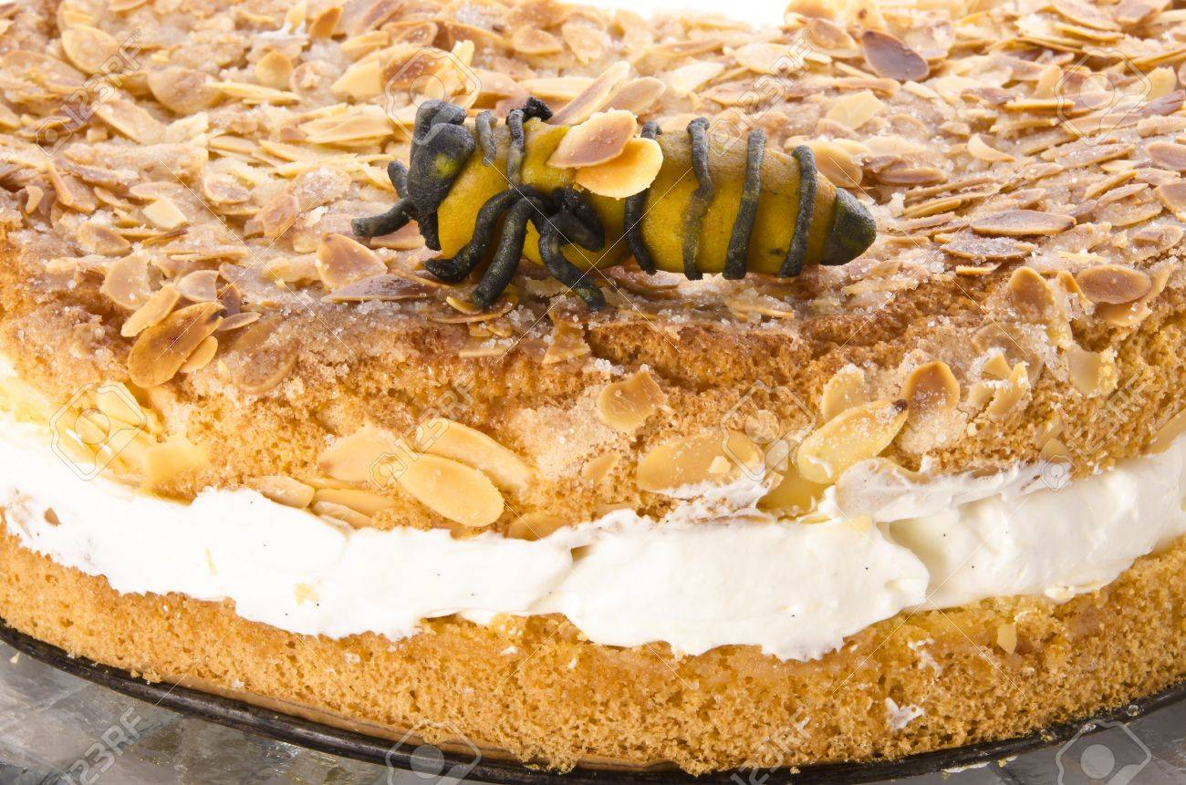 flat cake with an almond and sugar coating and a custard or cream filling Stock Photo - 14399191