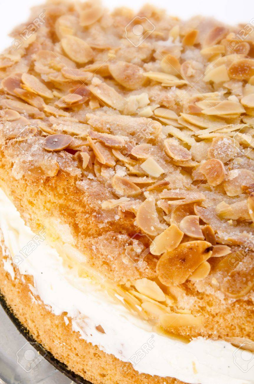 flat cake with an almond and sugar coating and a custard or cream filling Stock Photo - 14433808