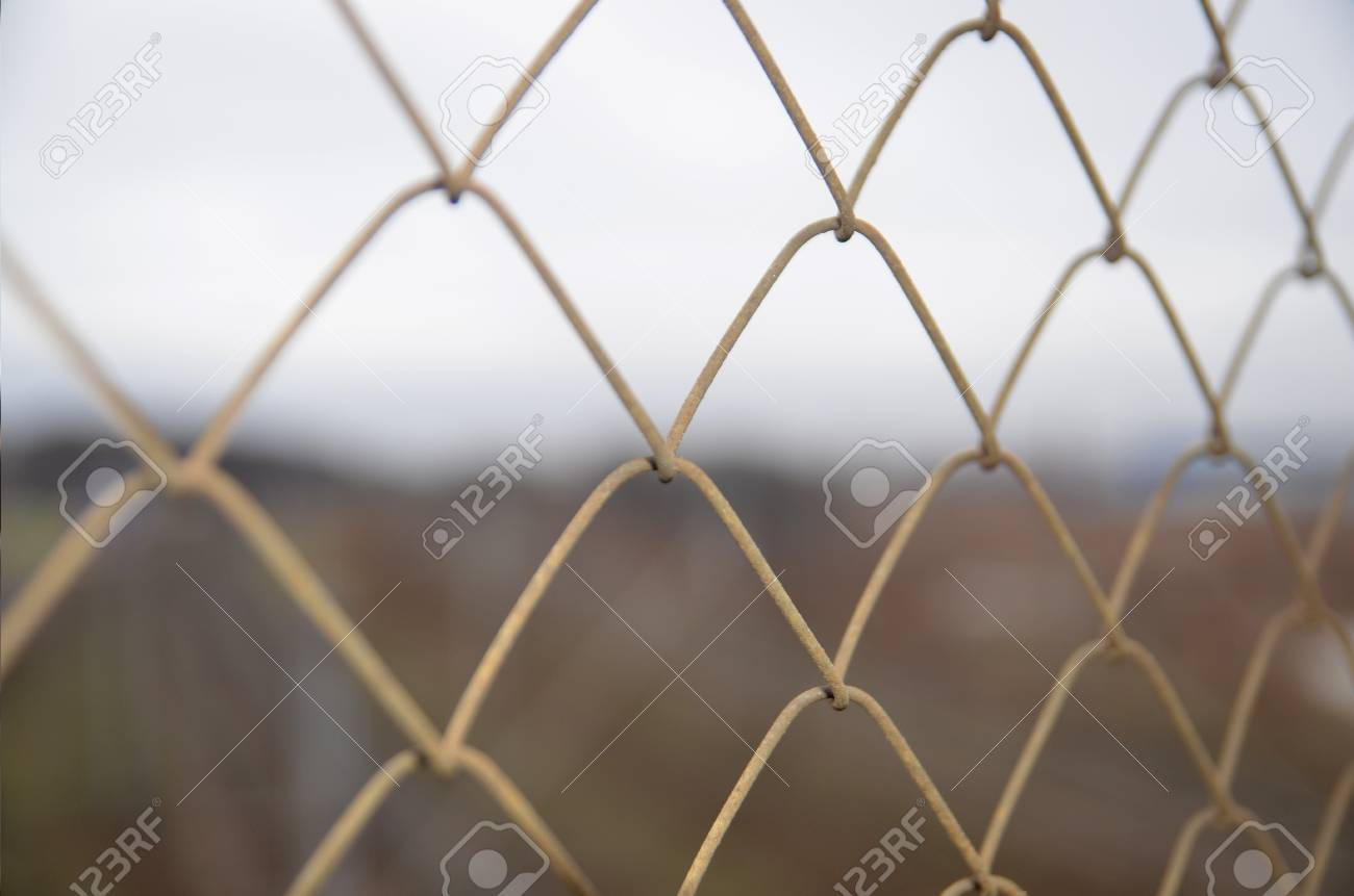 chain link grid fence close view prison concept stock photo