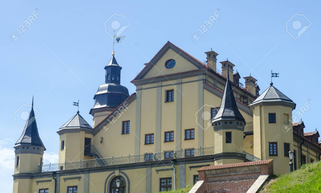 Ancient Castle Standing On Green Hills Towers And Flags Of A
