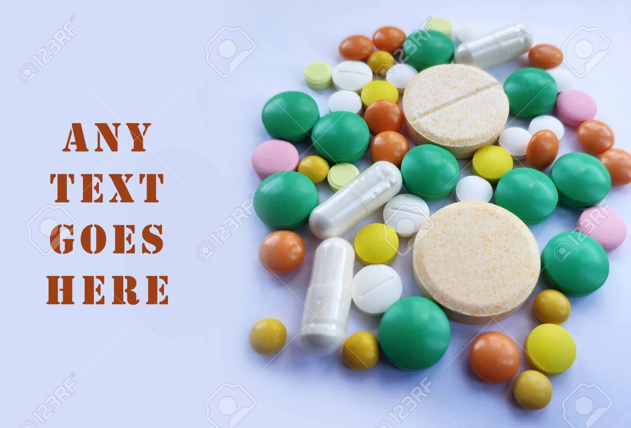 Stack of colorful pills, medicine background. Tablets prescribed for different diseases, health care background, colored pills. Medical conceptual photo background - 144202269