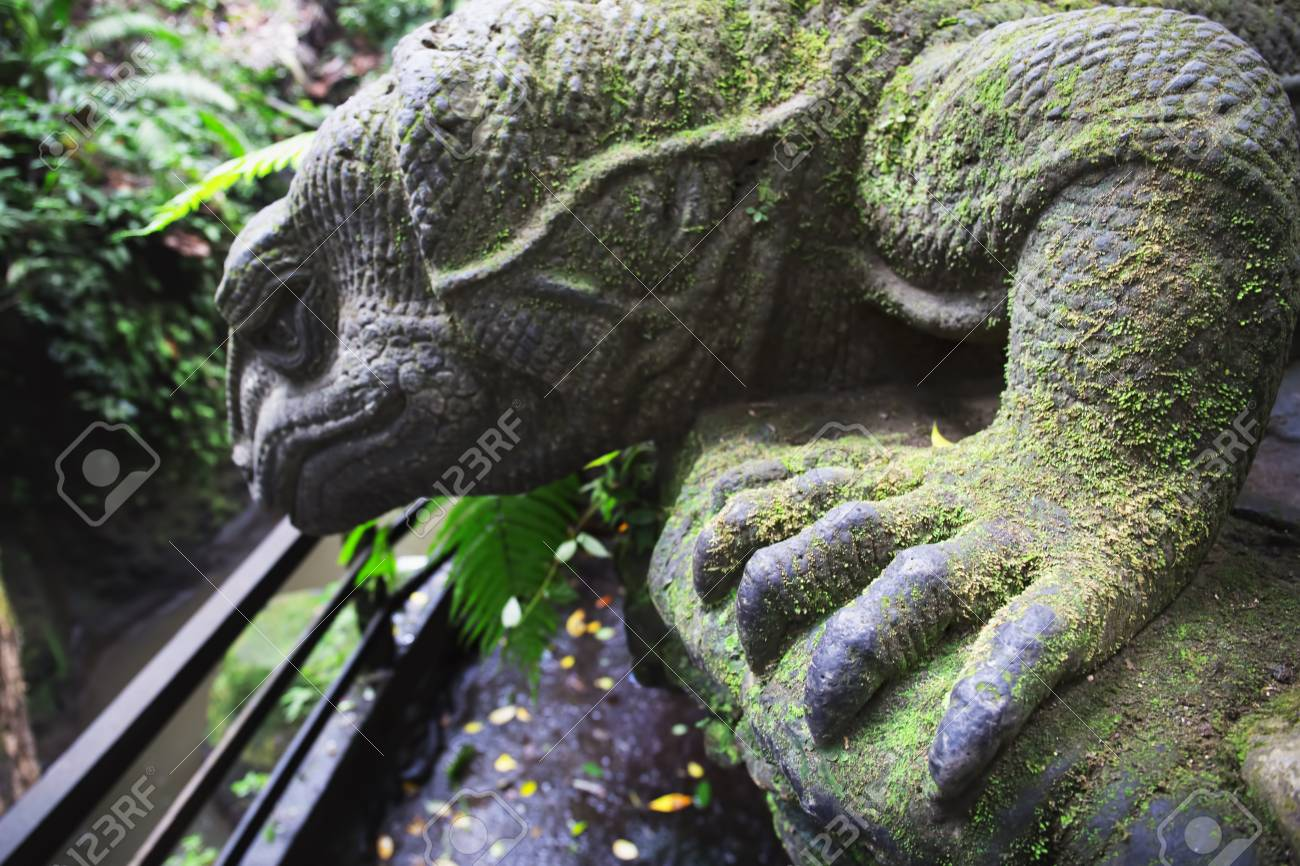 Carvings depicting animals gods and balinese mythological deities
