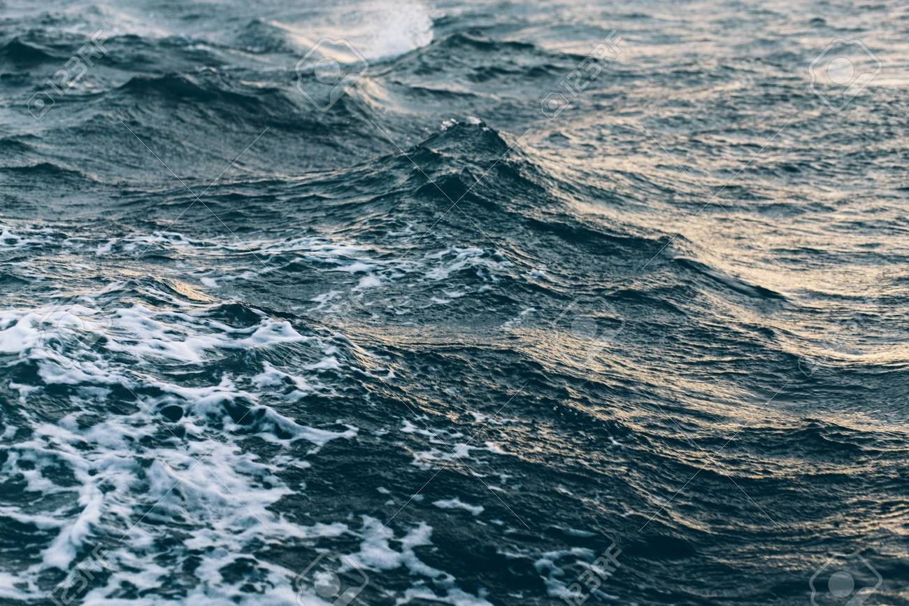 ripples on blue sea water , natural sea background concept - 122686387