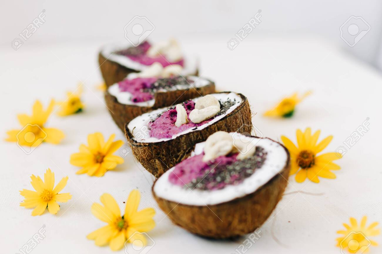 Four Plates Of Natural Coconut Shell With A Healthy Breakfast Stock Photo Picture And Royalty Free Image Image 141749642