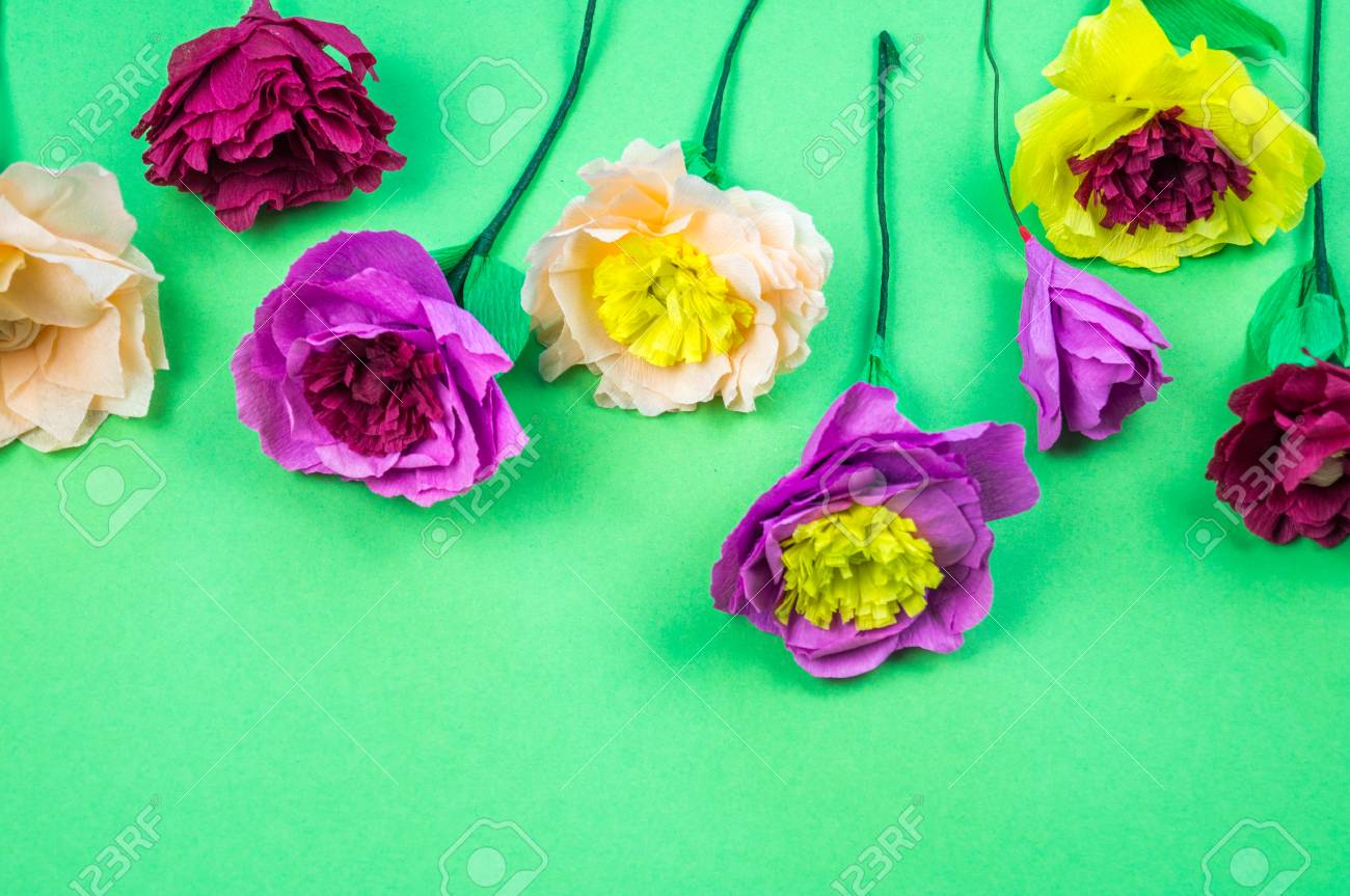 Utensils And Tools For Making Crepe Paper Flowers On Green Background