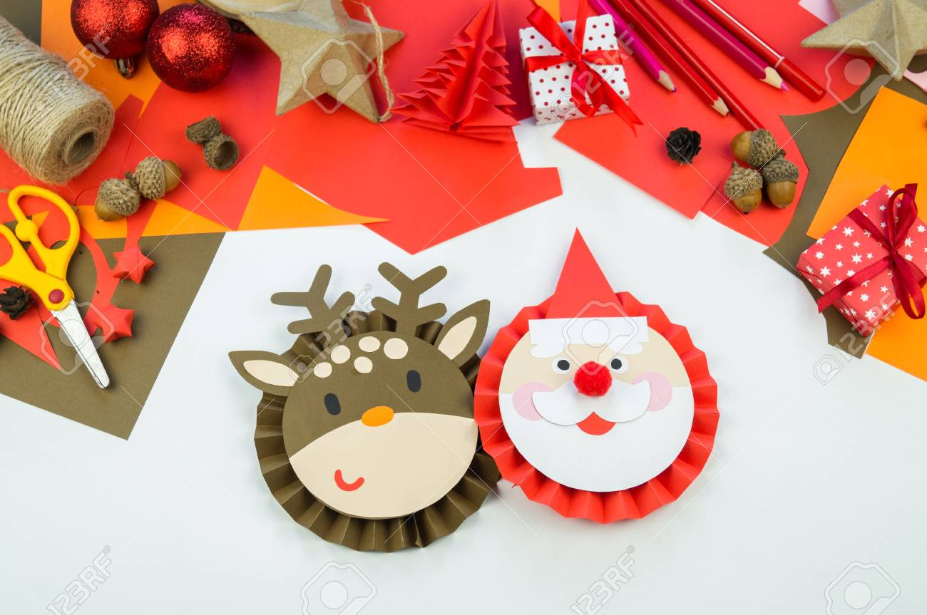 Kid Makes A Deer And Santa Claus Out Of Paper Christmas Crafts