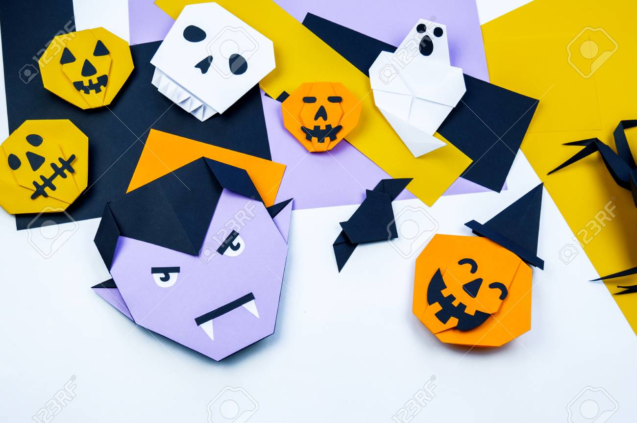 Origami Halloween  Bat, ghost, pumpkin, vampire paper  Copy spase