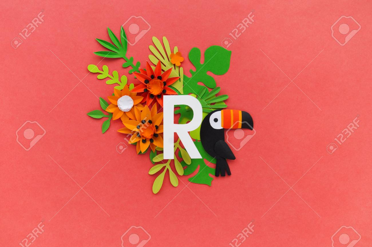 Letter R Of The Alphabet Cut Out Of White Paper Surrounded By