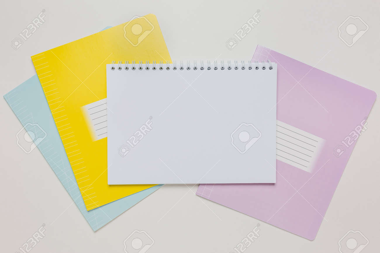 Notepad and exercise book on the desk. Mock up in copy space office on white background. Back to school - 173643850