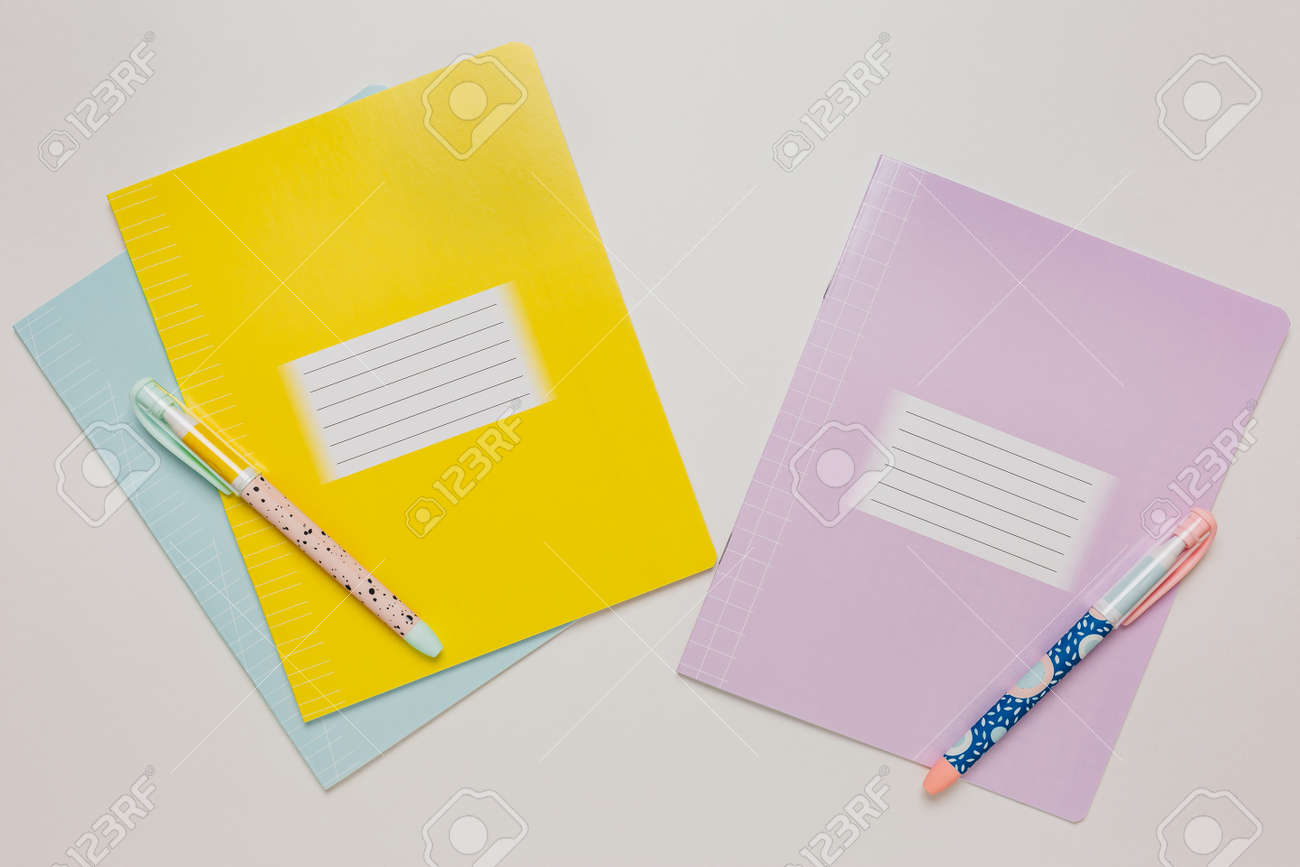 Notepad, exercise book and pen on the desk. Mock up in copy space office on white background. Back to school - 173757499