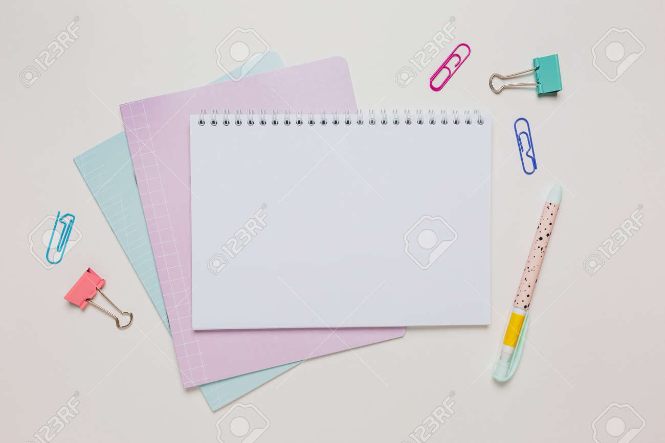 Notepad, exercise book and pen on the desk. Mock up in copy space office on white background. Back to school - 173799858