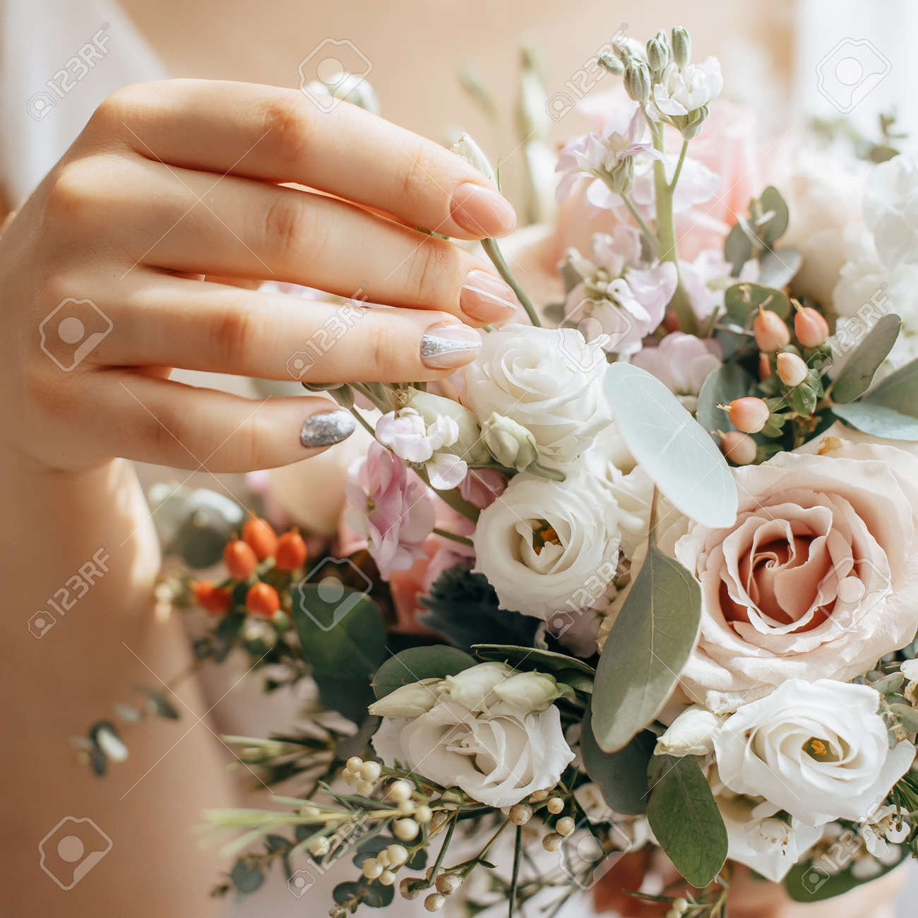 Bride holding wedding bouquet with white and pink flowers - 173799847