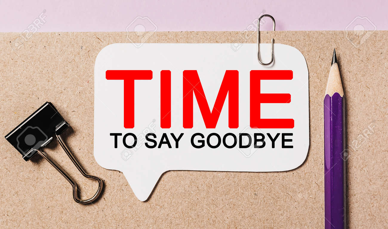 Text Time to Say Goodbye on a white sticker with office stationery background. Flat lay on business, finance and development concept - 173945794