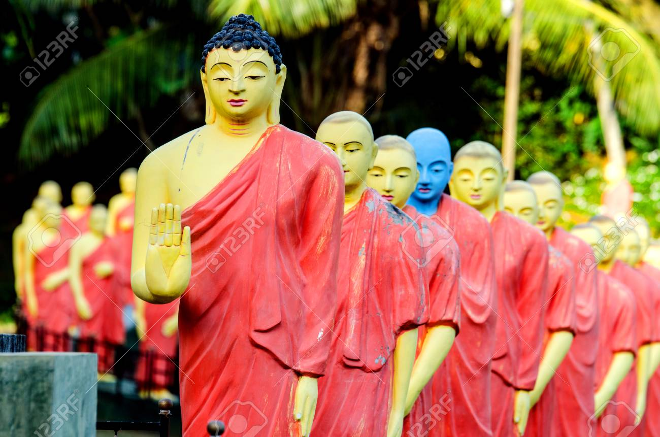 The statue of Buddha, behind which are statues of Buddhist monks. Sri Lanka. - 105359639