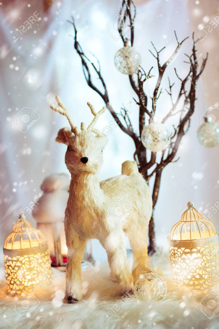 snow christmas decoration with fairy white deer and warm candles magic holiday background stock