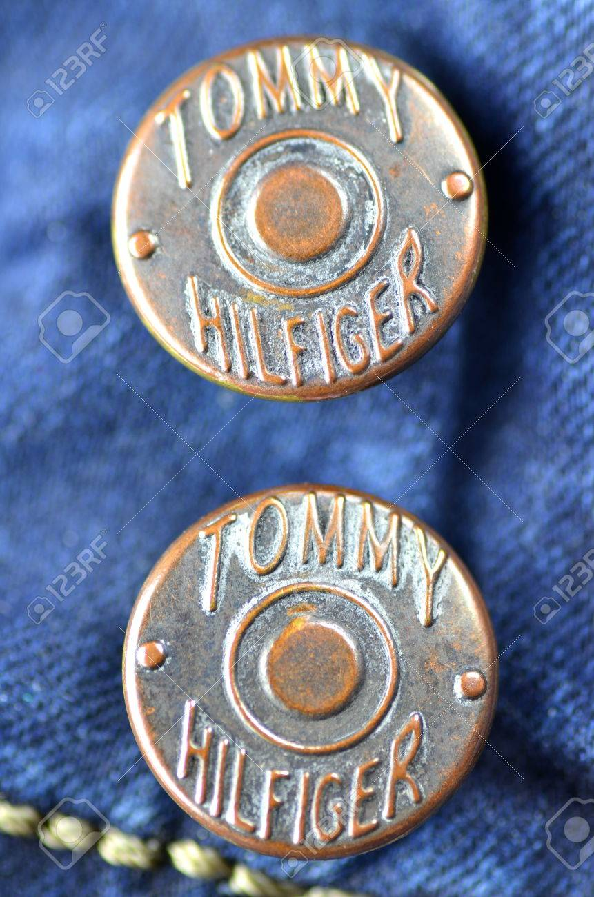 64e50748 Closeup Of Tommy Hilfiger Button On Blue Jeans Stock Photo, Picture ...