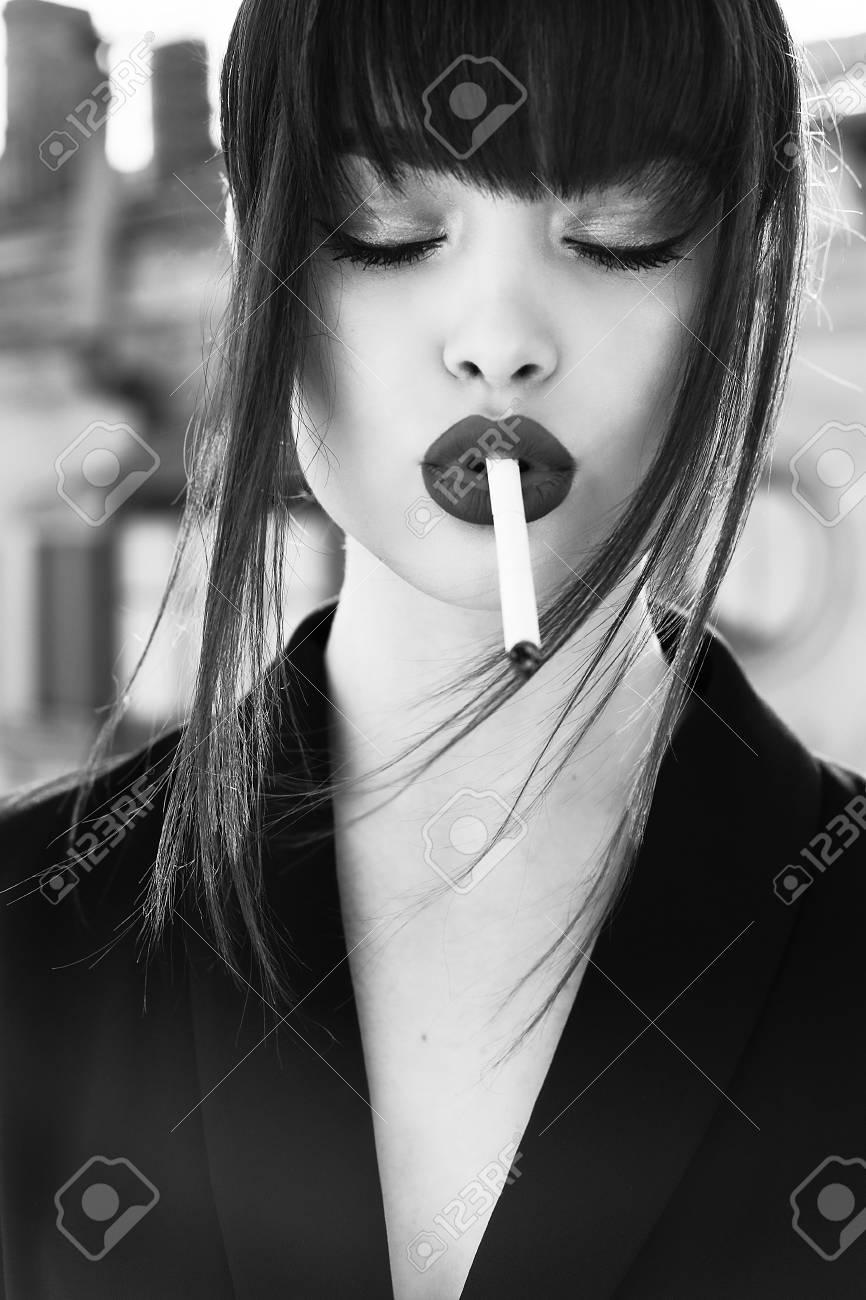 https://previews.123rf.com/images/dariya2/dariya21707/dariya2170700022/82607980-fashion-photo-of-gorgeous-woman-with-dark-hair-in-elegant-clothes-posing-at-studio-smoking-cigarette.jpg