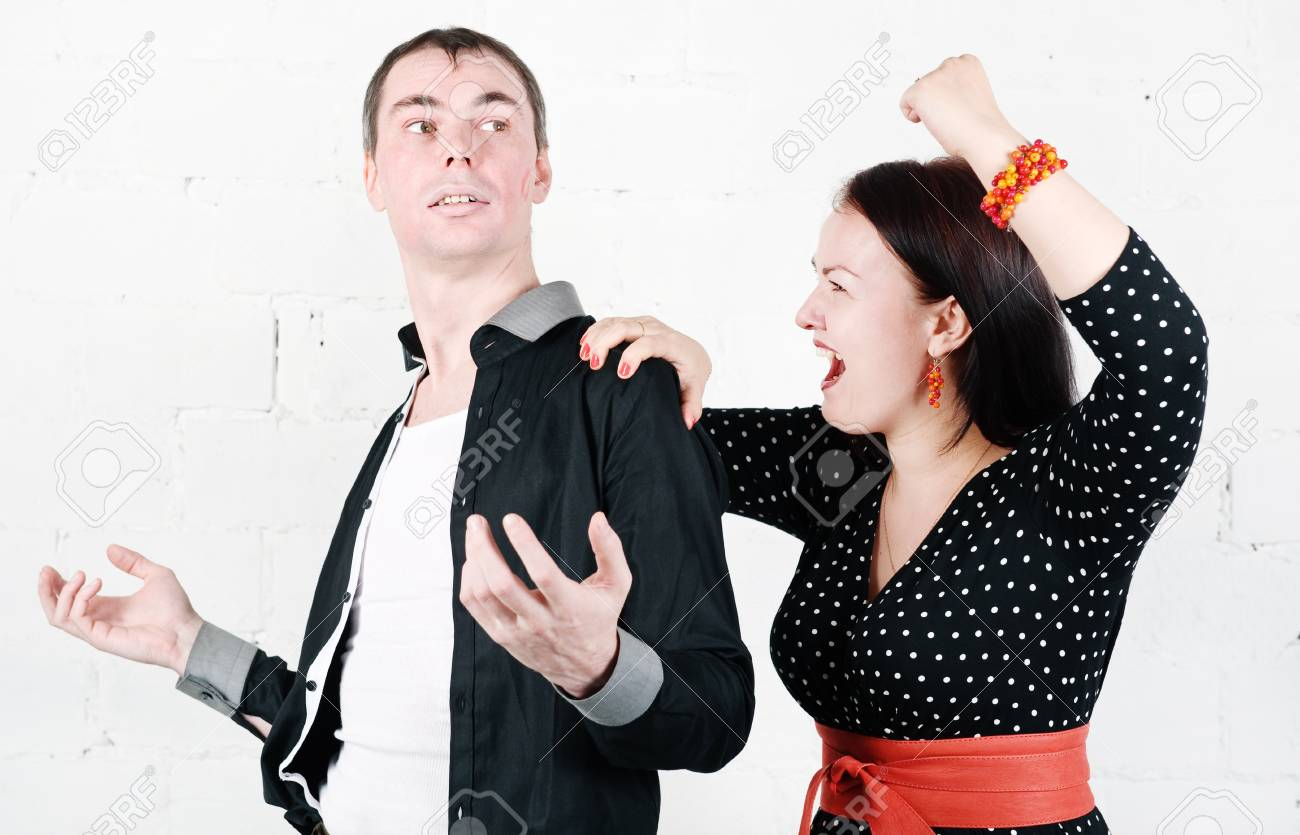 Jealous woman striking at her kissed man Stock Photo - 17276842