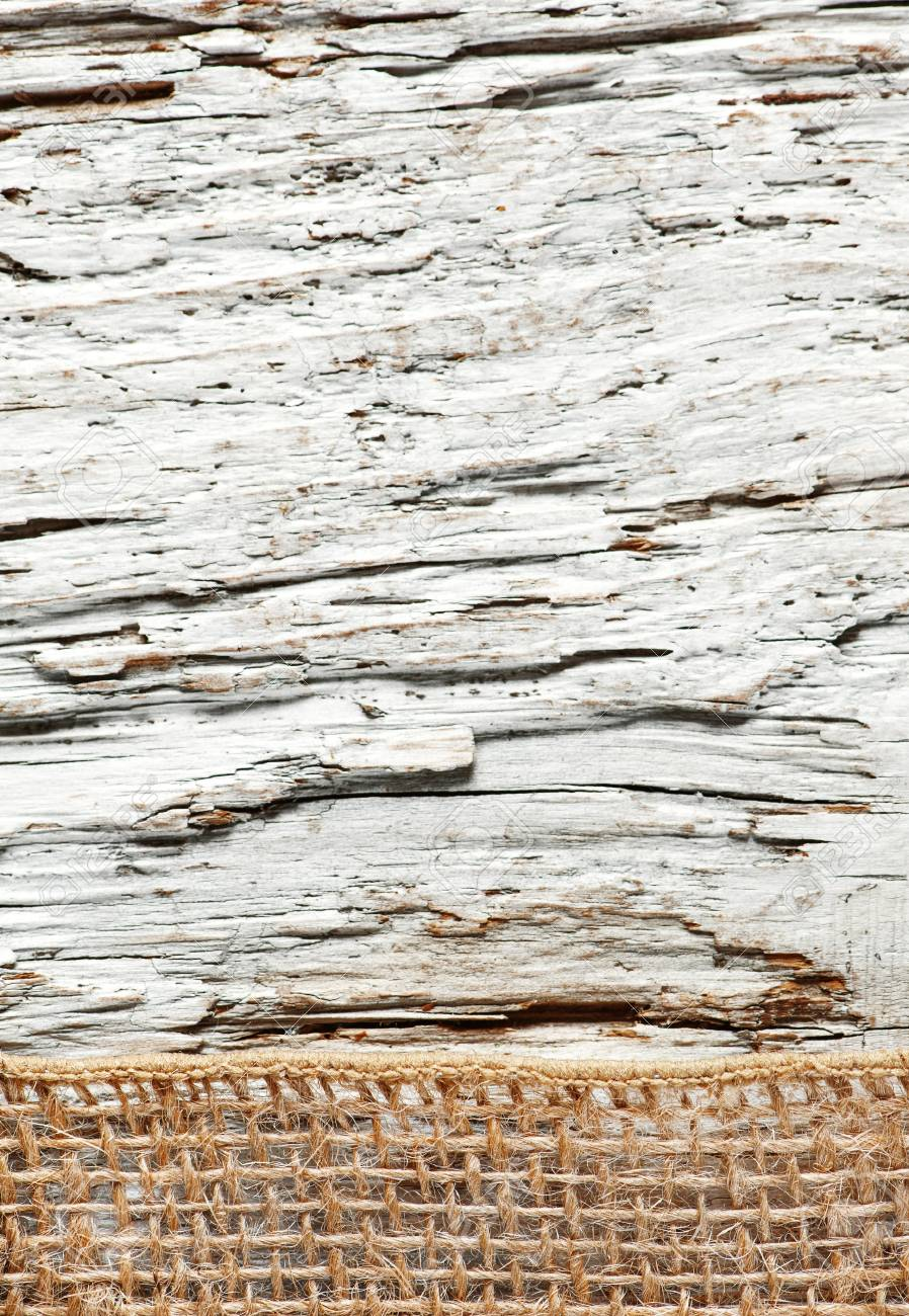 Old rough wooden background with sacking ribbon Stock Photo - 20824383