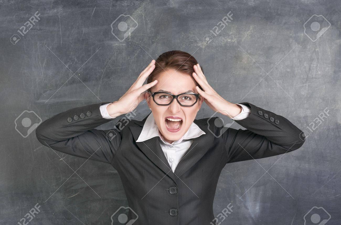 Screaming teacher on the school blackboard background Stock Photo - 20897486