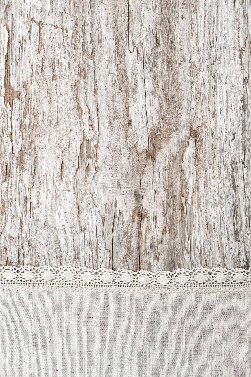 Linen Fabric With Lace On The Old Rustic Wooden Background Stock Photo
