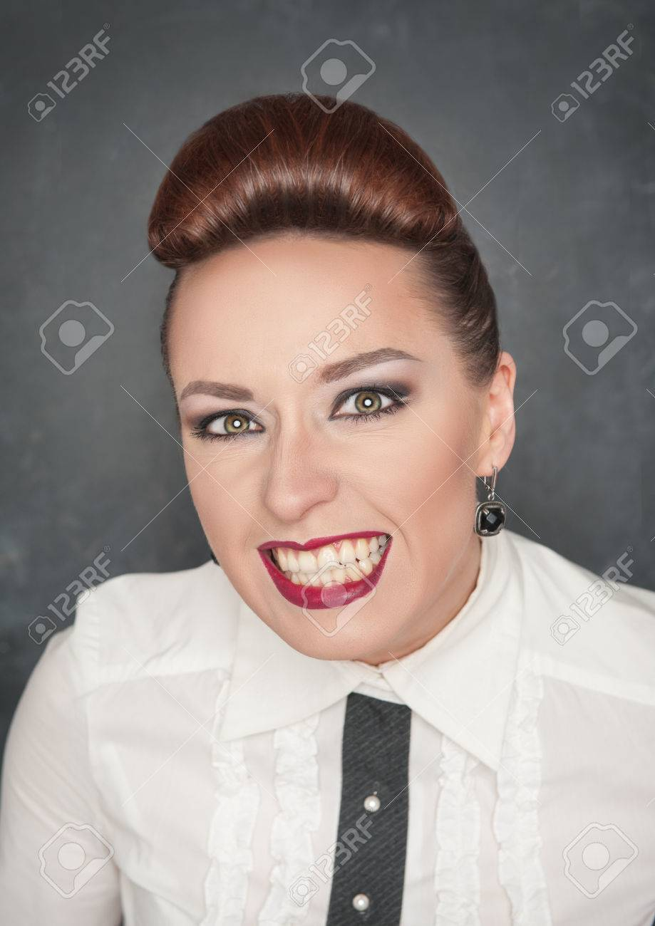 Angry woman with teeth grin on the blackboard background Stock Photo - 25931593