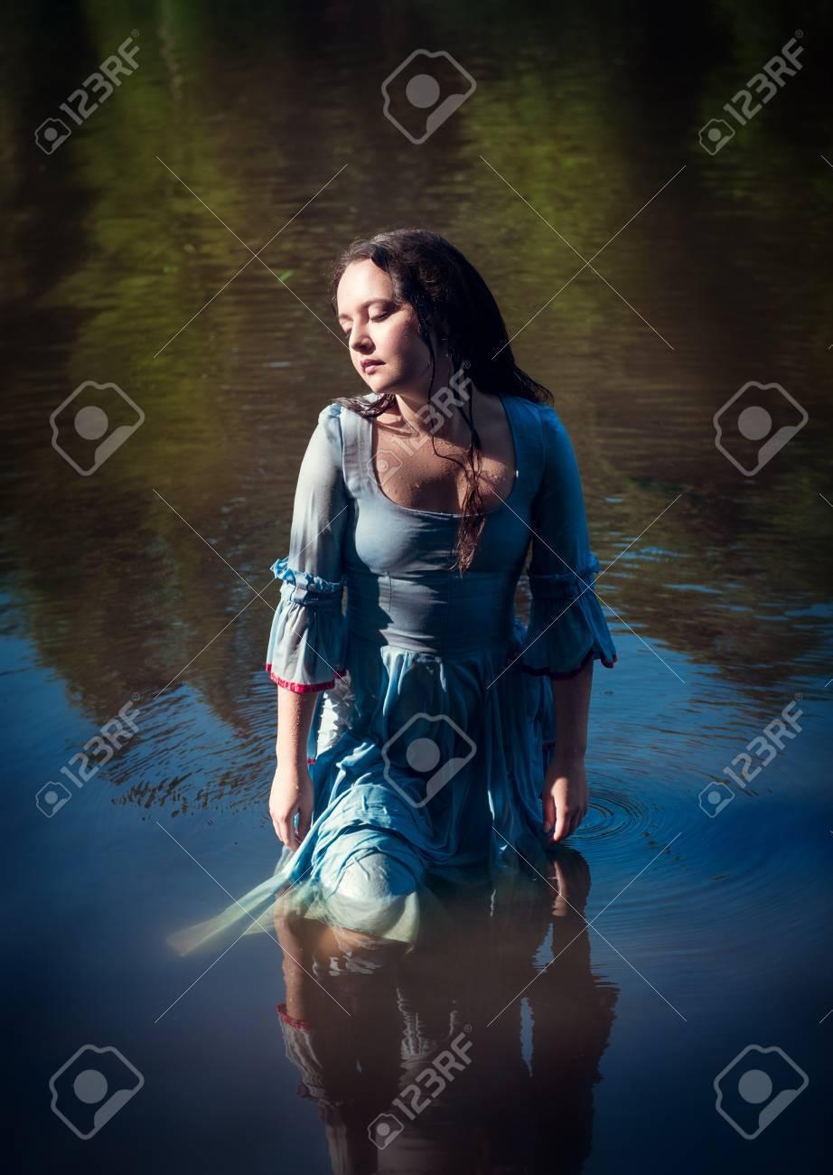 Verwonderlijk Young Beautiful Girl In Long Blue Dress Standing In The River GX-13