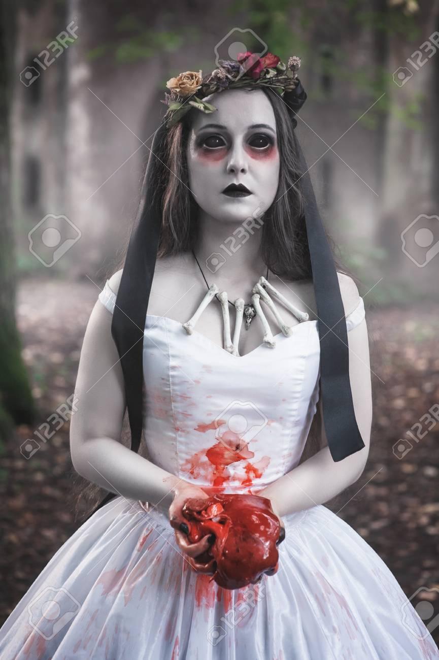 Halloween Bride.Creepy Dead Bride With Bloody Meat In Hand Halloween Scene